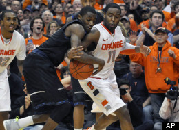 Syracuse's Scoop Jardine, right, knocks the ball loose from Georgetown's Jason Clark, forcing a turnover to end the game in overtime, in an NCAA college basketball game in Syracuse, N.Y., Wednesday, Feb. 8, 2012. (AP Photo/Kevin Rivoli)