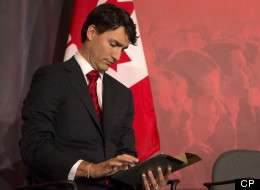 Justin Trudeau checks notes on his iPad as he takes part in the Liberal Leadership debate in Mississauga Ont., Saturday, February 16, 2013. (THE CANADIAN PRESS/Chris Young)