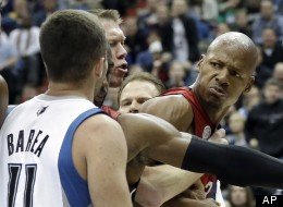 Miami Heat's Ray Allen, right, is separated by a teammate and an official is he jaws with Minnesota Timberwolves' J.J. Barea in the second half of an NBA basketball game Monday, March 4, 2013, in Minneapolis. Barea was ejected after a flagrant foul was called on him. (AP Photo/Jim Mone)