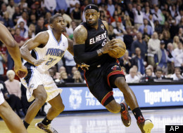 Miami Heat's LeBron James (6) drives around Orlando Magic's DeQuan Jones (20) on his way to shooting the go-ahead layup with 3.2 seconds left in their NBA basketball game in Miami, Wednesday, March 6, 2013. (AP Photo/J Pat Carter)
