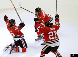 Chicago Blackhawks left wing Daniel Carcillo, left, celebrates his winning goal with Niklas Hjalmarsson (4), of Sweden, and Johnny Oduya (27), also of Sweden, during the third period of an NHL hockey game against the Colorado Avalanche, Wednesday, March 6, 2013, in Chicago. (AP Photo/Charles Rex Arbogast)