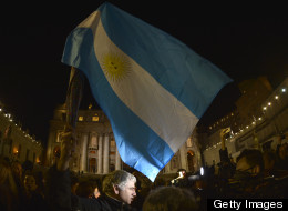 People wave an Argentinian flag at St. Peter's square after Pope Francis, formerly known as Argentina's Cardinal Jorge Bergoglio, was elected the 266th pope of the Catholic Church on March 13, 2013.