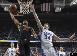 Maryland's Dez Wells (32) drives to the basket against Duke's Ryan Kelly (34) during the first half of an NCAA college basketball game at the Atlantic Coast Conference men's tournament in Greensboro, N.C., Friday, March 15, 2013. (AP Photo/Gerry Broome)