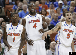 Florida's Kenny Boynton (1), Patric Young (4), and Scottie Wilbekin (5) watch during the final moments of a second-round game of the NCAA men's college basketball tournament Friday, March 22, 2013, in Austin, Texas.