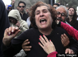 A Cypriot woman gets emotional during a protest outside the parliament building in the capital Nicosia on March 22, 2013. (Yiannis Kourtoglou/AFP/Getty Images)