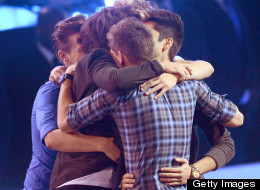 One Direction hug it out.