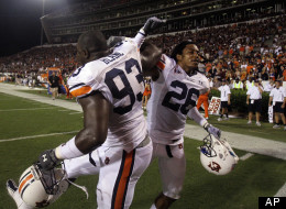 Auburn defensive tackle Mike Blanc (93) and safety Mike McNeil (26) celebrate their 17-14 victory over Mississippi State in their NCAA college football game in Starkville, Miss., Thursday, Sept. 9, 2010. (AP Photo/Rogelio V. Solis)