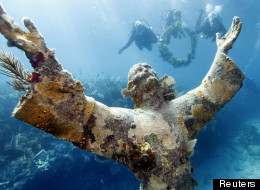 A bronze statue of the Christ of the Abyss lies submerged under 25 feet of water off the Cost of Key Largo in Florida. (Reuters)