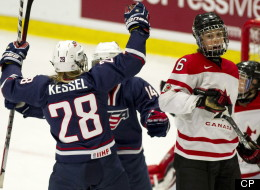 Team Canada's Rebecca Johnston looks over as Team USA's Amanda Kessel (28) and Brianna Decker celebrate a goal by teammate Kendall Coyne during first period gold medal hockey action at the World Women's Ice Hockey Championships Saturday, April 14, 2012 in Burlington, Vermont. THE CANADIAN PRESS/Paul Chiasson