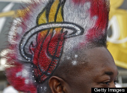 Gasmy Joseph shows off his white-hot Heat Mohawk before the start of Game 6 of the NBA Finals between the Miami Heat and the Dallas Mavericks at the AmericanAirlines Arena in Miami, Florida, Sunday, June 12, 2011. (Al Diaz/Miami Herald/MCT via Getty Images)