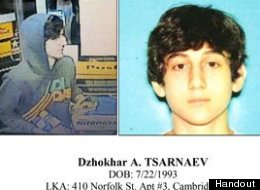 This image provided by the Boston Regional Intelligence Center shows Dzhokhar A. Tsarnaev, one of the suspects in the Boston Marathon bombings. Authorities say Tsarnaev is still at large after he and another suspect — both identified to The Associated Press as coming from the Russian region near Chechnya — killed an MIT police officer, injured a transit officer in a firefight and threw explosive devices at police during their getaway attempt in a long night of violence into the early hours o
