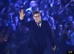 k.d. lang waves to the crowd after receiving a Juno for her Canadian Music Hall of Fame induction during the 2013 Juno Awards in Regina on Sunday, April 21, 2013. (THE CANADIAN PRESS/Liam Richards)