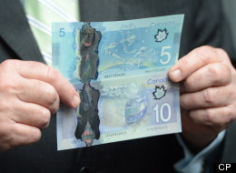 Canada's new plastic $5 and $10 bills got a stellar welcome Tuesday — literally. (The Canadian Press/Sean Kilpatrick)