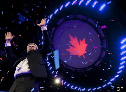 Prime Minister Stephen Harper waves to the crowd following his speech on election night in Calgary, Alta, May 2, 2011. THE CANADIAN PRESS/Jonathan Hayward