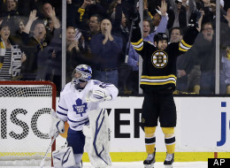 Boston Bruins right wing Nathan Horton, right, celebrates his goal against Toronto Maple Leafs goalie James Reimer (34) in the first period in Game 1 of a first-round NHL hockey playoff series in Boston, Wednesday, May 1, 2013. (AP Photo/Elise Amendola)