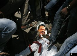 Indian Tamil activists and supporters stomp on a portrait of Sri Lankan President Mahinda Rajapaksa during a protest against Sri Lanka's alleged wartime abuses in Chennai, India, Thursday, March 21, 2013. (AP Photo/Arun Sankar K.)