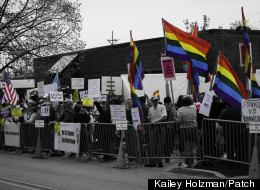 LGBT supporters and the Illinois Family Institute held a rally against one another in Downers Grove, Ill. on Saturday.