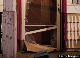 The smashed front door of the house where, on Monday, three women who had disappeared as teenagers approximately 10 years ago were found alive on May 7, 2013, in Cleveland, Ohio. Amanda Berry, who went missing in 2003, Gina DeJesus, who went missing in 2004, and Michele Knight, who went missing in 2002, were all found alive in the same house. Three suspects, all brothers, have been taken into custody. (Photo by Bill Pugliano/Getty Images)