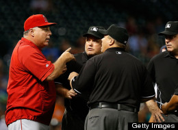 Manager Mike Scioscia of the Los Angeles Angels of Anaheim argues a call with the umpire crew in the seventh inning during the game against the Houston Astros at Minute Maid Park on May 9, 2013 in Houston, Texas. (Photo by Scott Halleran/Getty Images)