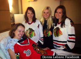 Donna Lebano (seated) surrounded by her sisters smiles after giving birth following the Blackhawks' Thursday playoffs win over the Minnesota Wild. Lebano experienced contractions in the second period but stayed for Chicago's victory before heading to the hospital. (Donna Lebano Facebook)