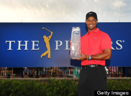 Tiger Woods poses with the winner's trophy after the final round of THE PLAYERS Championship on THE PLAYERS Stadium Course at TPC Sawgrass on May 12, 2013 in Ponte Vedra Beach, Florida. (Photo by Stan Badz/PGA TOUR)