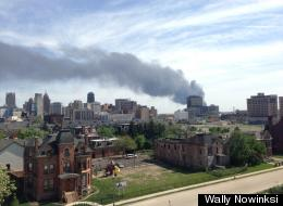 A fire in Windsor, Canada on Tuesday, May 21, 2013 as seen from the Brush Park neighborhood in Detroit. The massive fire started in the afternoon at a warehouse on Sprucewood Avenue in the western part of the city. Photo via Wally Nowinski.