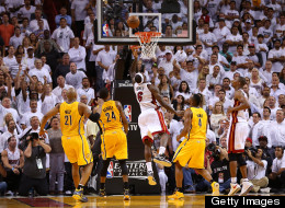 LeBron James #6 of the Miami Heat drives and makes the game winning basket in overtime against the Indiana Pacers during Game One of the Eastern Conference Finals at AmericanAirlines Arena on May 22, 2013 in Miami, Florida.