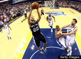 Manu Ginobili #20 of the San Antonio Spurs goes up for a shot against Quincy Pondexter #20 and Marc Gasol #33 of the Memphis Grizzlies in the first half during Game Three of the Western Conference Finals of the 2013 NBA Playoffs at the FedExForum on May 25, 2013 in Memphis, Tennessee.