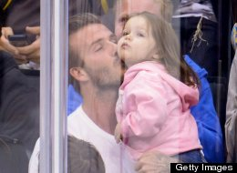 David Beckham kisses daughter Harper Beckham on the Kiss Cam.