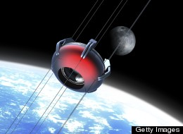 Illustration of a futuristic space elevator rising into orbit with the moon in background. The space elevator uses a carbon nanotube ribbon that stretches from the surface of the earth to a counterweight in space.