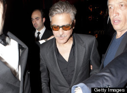 George Clooney denies holding hands with his ex-fling, Monika Jakisic, at Loulou Restaurant, Mayfair on May 25 in London. (Niki Nikolova/FilmMagic)