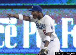 Yasiel Puig #66 of the Los Angeles Dodgers celebrates his throw to first base for a double play to end the game and preserve a 2-1 win over the San Diego Padres during the eighth inning at Dodger Stadium on June 3, 2013 in Los Angeles, California.