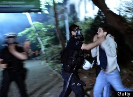 A riot policeman detains a demonstrator in Istanbul on June 4, 2013.  (Photo by ARIS MESSINIS/AFP/Getty Images)