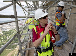 Secretary of the Interior Sally Jewell, center, speaks at the 491-foot level of the scaffolding surrounding the Washington Monument, after climbing a ladder to the top of the monument's pyramidion, Sunday, June 2, 2013 in Washington. The monument has been closed since the 2011 earthquake and half of the needed repairs have been funded by a $7.5 million donation from philanthropist David Rubenstein. The Associated Press had a look at some of the worst damage and the preparations underway to begin