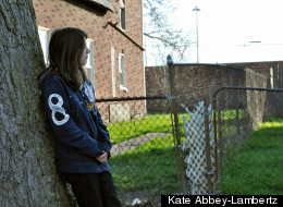 Seventeen-year-old A. Romano stands in her southwest Detroit neighborhood. In a span of three months, three people she knew were shot to death.