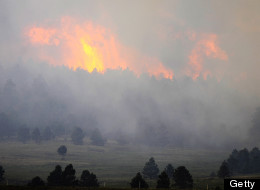 COLORADO SPRINGS, CO - JUNE 12:  Fire from the Black Forest Fire burns behind a stand of trees June 12, 2013 near Colorado Springs, Colorado. The fire has reportedly burned more than 360 homes and has charred at least 8,000 acres. (Photo by Chris Schneider/Getty Images)