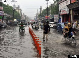 The main road near the old bus depot  in Ghaziabad, India, flooded on June 16, 2013. (Photo by Sakib Ali/Hindustan Times via Getty Images)