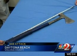Daytona Beach police said a suspect threw this 2-foot roofing ax through the rear window of a car Friday, injuring two teens.