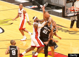 LeBron James #6 of the Miami Heat goes up to shoot against Tim Duncan #21 of the San Antonio Spurs during Game Six of the 2013 NBA Finals on June 18, 2013 at American Airlines Arena in Miami, Florida.