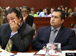 Jury consultant Robert Hirschhorn (left) and defendant George Zimmerman listen to a prospective juror in Seminole circuit court on June 18. (Photo by Joe Burbank-Pool/Getty Images)