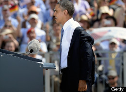 President Barack Obama removed his jacket in front of an applauding crowd at the Brandenburg Gate on Wednesday. (Photo by CHRISTOF STACHE/AFP/Getty Images)