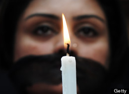 According to a new WHO report, one in three women experience sexual or physical violence. In this photograph, an Indian member of social organization Our City Our Right holds a candle during a silent protest following the recent gang rape and murder of a 20-year-old college student in Barasat, in Kolkata on June 15, 2013. Activists and social groups in various parts of the state held rallies and protests following the incident. (Image credit: AFP PHOTO/ Dibyangshu SARKAR/Getty Images)