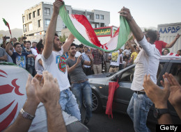 TEHRAN, IRAN - JUNE 18:  Iranian football fans celebrate at Shahrak-e-Gharb area in north-west Tehran on June 18, 2013 after Iran won their 2014 World Cup Asian zone group A qualifying football match against South Korea. Hundreds of joyous Iranians flooded the streets of Tehran after the national team beat South Korea 1-0 in an away game to qualify for the 2014 Brazil World Cup  (Photo by Majid Saeedi/Getty Images)