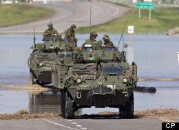 The Canadian Army makes its presence felt as it arrives to provide assistance in the ravaged town of High River. (CP)