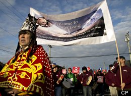Leaders of the Gitga'at First Nation, from Hartley Bay, BC, lead a protest march at the No to Tankers rally, at Prince Rupert, BC, Feb. 4, 2012. The equity offer from Northern Gateway to aboriginal groups along the route of a controversial oil pipeline would amount to an average of about $70,000 a year for the bands, which would be obliged to borrow the millions of dollars needed to purchase equity from Calgary-based Enbridge itself. (The Canadian Press Images/Robin Rowland)