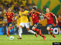 Neymar of Brazil competes with Jordi Alba of Spain during the FIFA Confederations Cup Brazil 2013 Final.