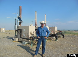 John Fenton, a local farmer, stands next to an Encana Corp. gas well near his home in Pavillion, Wyoming, U.S., on July 5, 2012. (Photo: Mark Drajem/Bloomberg via Getty Images)