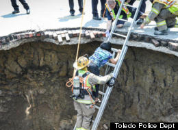 A northwest Ohio sinkhole has swallowed a car traveling down a street and briefly trapped the driver, Pamela Knox, 60. She climbed out after authorities gave her a ladder.