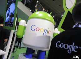 An Android operating software icon sits on display with a Google Inc. logo at the Google booth at the Mobile World Congress in Barcelona, Spain, on Wednesday, Feb. 29, 2012. The Mobile World Congress, operated by the GSMA, expects 60,000 visitors and 1400 companies to attend the four-day technology industry event which runs Feb. 27 through March 1. Photographer: Denis Doyle/Bloomberg via Getty Images