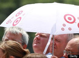 TORONTO, ON - JUNE 24: Toronto Mayor Rob Ford seeks shelter from the sun under Doug Holyday's umbrella as he  makes an appearance at the raising of the Rainbow flag to kick off Pride Week festivities on the Podium roof at City Hall.        (Steve Russell/Toronto Star via Getty Images)